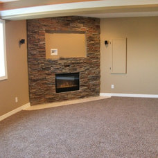 Traditional Basement by Precision Construction