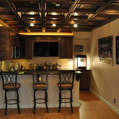 traditional basement by Blue Line Building Co.