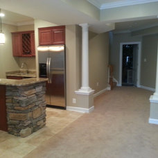 Traditional Basement by DLS Construction Group