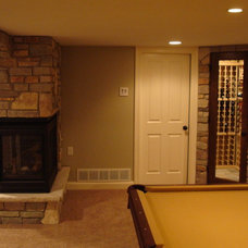 Eclectic Basement by Arbuckle Design Builders, LLC