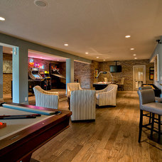 Traditional Basement by Maxine Schnitzer Photography