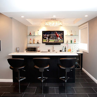 Basement - mid-sized underground carpeted and black floor basement idea in Minneapolis with gray walls and no fireplace