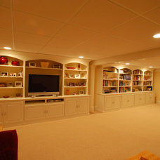 Basement by Signature Construction and Design