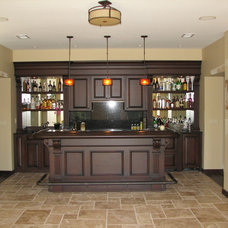 Traditional Basement by Stoneleigh Builders LLC.