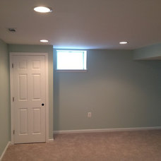 Traditional Basement by TailorCraft Builders, Inc.