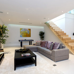 Inspiration for a contemporary look-out basement in London with white walls and white floors.