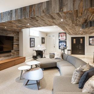 Réalisation d'un sous-sol tradition enterré et de taille moyenne avec un mur marron, moquette, une cheminée standard, un manteau de cheminée en bois et un sol beige.