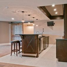 Traditional Basement by Redstart Construction Inc.