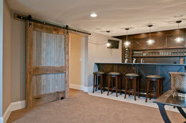 Traditional Basement by Redstart Construction Inc.