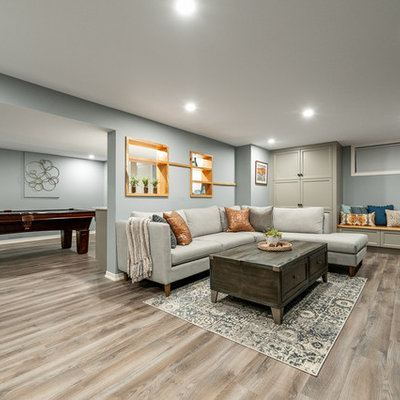 Basement - small craftsman look-out laminate floor and gray floor basement idea in Ottawa with blue walls and no fireplace