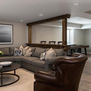 Idée de décoration pour un sous-sol champêtre semi-enterré et de taille moyenne avec un sol en vinyl, une cheminée ribbon, un sol marron, un mur beige et un manteau de cheminée en béton.