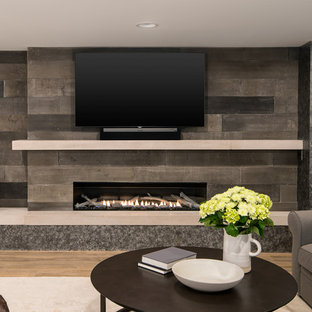 Basement - mid-sized cottage look-out vinyl floor and brown floor basement idea in Detroit with beige walls, a ribbon fireplace and a concrete fireplace