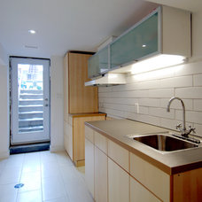 Modern Basement by blackLAB architects inc.