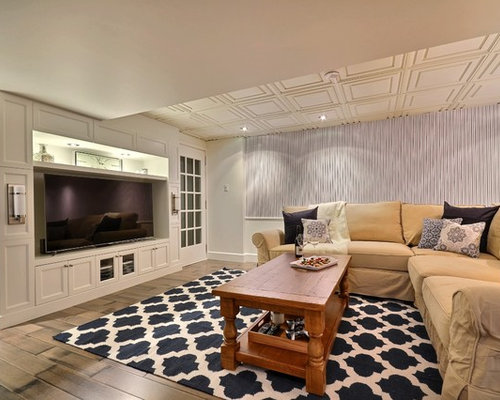 Example Of A Transitional Underground Dark Wood Floor And Gray Floor  Basement Design In Montreal With