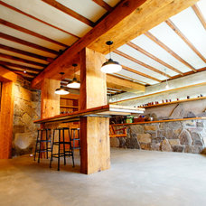 Contemporary Basement by Cairn Construction Inc.