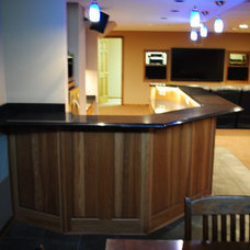 Contemporary Basement by North Coast Home Improvement Corp.