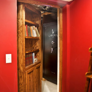 Example of a mid-sized classic basement design in Milwaukee with red walls and no fireplace