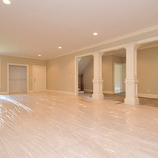 Traditional Basement by NEOCLASSICAL BUILDERS, llc