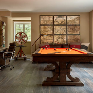 Example of a mid-sized transitional look-out medium tone wood floor and gray floor basement game room design in Philadelphia with beige walls