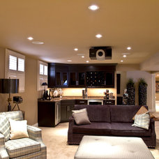 Contemporary Basement by IDH Build Group