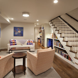 Mid-sized eclectic underground dark wood floor basement photo in DC Metro with gray walls and no fireplace