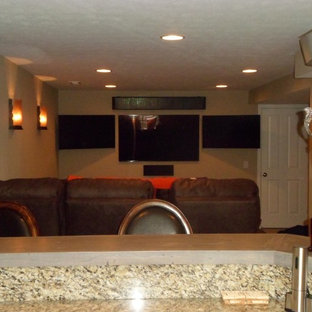 Basement - small modern underground carpeted basement idea in Indianapolis with beige walls