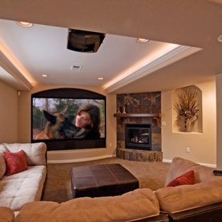 Basement - large transitional look-out carpeted basement idea in Denver with beige walls, a standard fireplace and a tile fireplace
