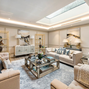 Inspiration for a medium sized traditional fully buried basement in London with beige walls.