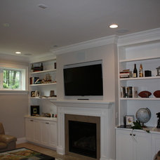 Traditional Basement by Hooked Up Installs, Inc