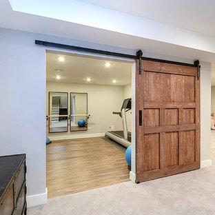 Design ideas for a large arts and crafts fully buried basement in Chicago with grey walls and dark hardwood floors.