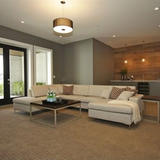 Contemporary Basement by Done to the Nines