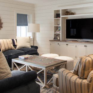 Example of a mid-sized beach style look-out basement design in Boston with white walls and no fireplace
