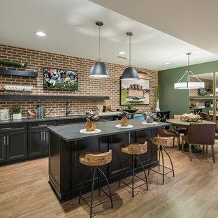 Basement - transitional medium tone wood floor and brown floor basement idea in Philadelphia with green walls