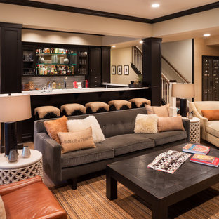 Inspiration for a large transitional underground light wood floor and beige floor basement remodel in Minneapolis with beige walls and a bar