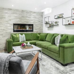 トロントの中サイズのコンテンポラリースタイルのおしゃれな地下室 (白い壁、淡色無垢フローリング、石材の暖炉まわり、ベージュの床、半地下 (窓あり) 、横長型暖炉) の写真