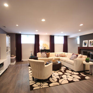 Inspiration for a large contemporary look-out medium tone wood floor and brown floor basement remodel in Chicago with gray walls and a tile fireplace