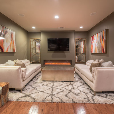 Inspiration for a transitional underground dark wood floor basement remodel in Atlanta with gray walls, a ribbon fireplace and a metal fireplace