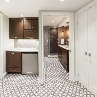 Inspiration for a large transitional underground concrete floor and gray floor basement remodel in Milwaukee with beige walls