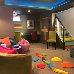 Example of a mid-sized eclectic look-out carpeted and beige floor basement design in New York with multicolored walls and no fireplace