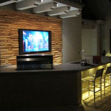 Contemporary Basement by Hasler Construction Management