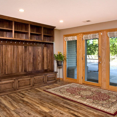 Inspiration for a mid-sized timeless look-out medium tone wood floor basement remodel in Minneapolis with beige walls and no fireplace
