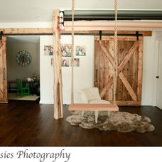 Rustic Basement by Spaces Interiors/Exteriors