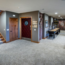 Traditional Basement by Rezac Construction