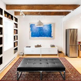 Cette image montre un sous-sol nordique de taille moyenne avec un mur bleu, un sol en bambou, aucune cheminée et un manteau de cheminée en brique.