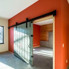 Contemporary Basement by Quartersawn Design Build
