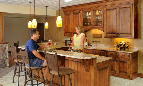 Traditional Basement by Mullet Cabinet