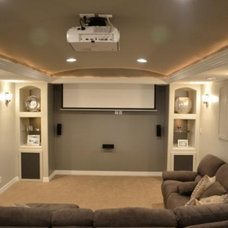 Traditional Home Theater by Precision Construction
