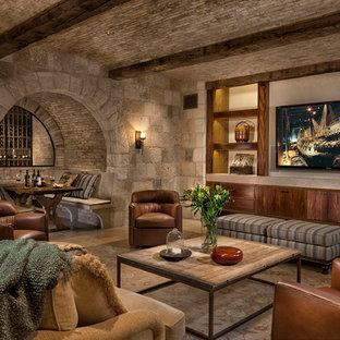Basement - mediterranean underground beige floor basement idea in Orange County with beige walls