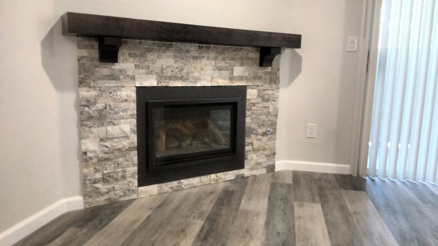 Dark cherry wood mantel with corbels