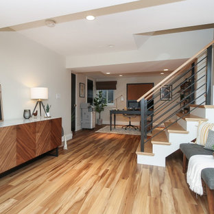 This is an example of a large midcentury fully buried basement in Chicago with grey walls, vinyl floors, no fireplace and brown floor.